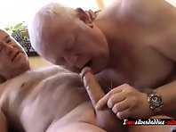 Fit grandpa jerking off big dick together with a married doggers in public toilets.